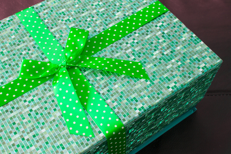 Gift box with green bow ribbon