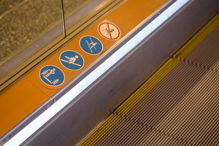 emergency stair: signs on an escalator, warning signs, the escalator at the mall