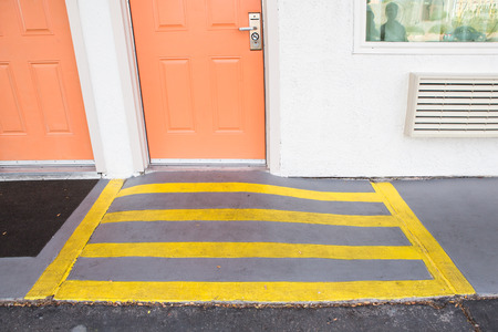 room entrance with ramp for disabled person and wheelchair