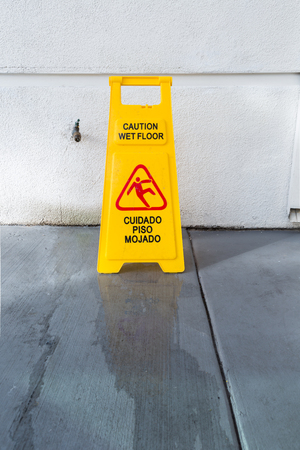 Slippery Floor Surface Warning Sign And Symbol In Building Hall