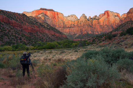 Dawn at Towers of the Virgin, Zion National Park, Utah in autumn with photographer