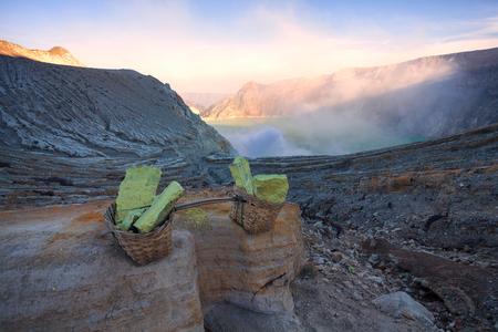 crater lake: Sulfur carriers basket at Kawah Ijen, Indonesia Stock Photo
