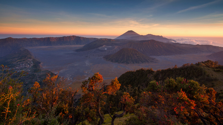 Mount Bromo volcano (Gunung Bromo) during sunset from viewpoint on Mount Penanjakan. located in Semeru National Park, East Java, Indonesia.