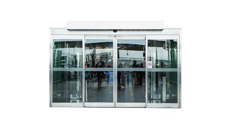 白い背景で隔離の自動ガラスのドア
