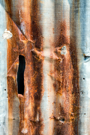 Old rusty zinc sheet wall or corrugated wall texture and background