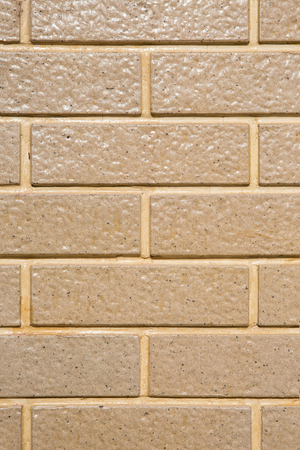 stucco facade: Light Brown Square brick block wall or floor background and texture