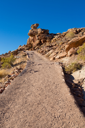 dirt path way up to hill in Arches national park Stock Photo