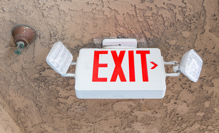 Exit sign with emergency light  and fire extinguishing system in the hotel 版權商用圖片