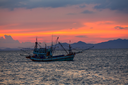 Fishing boat in the sea at sunset around southern part of thailand