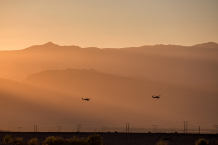 silhouette of small helicopter with sunset. Stock Photo