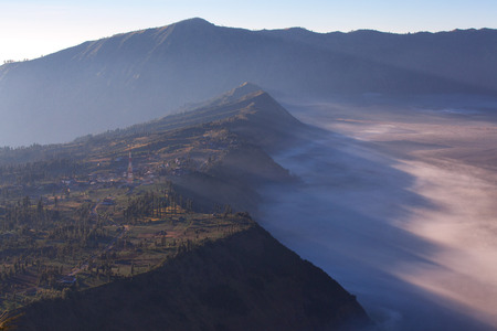 Mount Bromo volcano (Gunung Bromo) during sunrise from viewpoint on Mount Penanjakan. located in Semeru National Park, East Java, Indonesia.