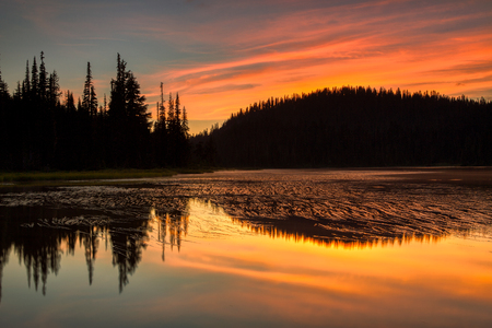 Scenic view of Mount Rainier reflected across the reflection lakes at sunset Stock Photo