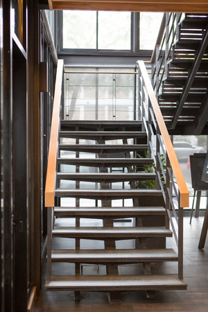 Indoor Concrete Staircase with wood handrail