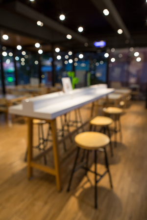 Table and chairs in Coffee shop blur background with bokeh 写真素材