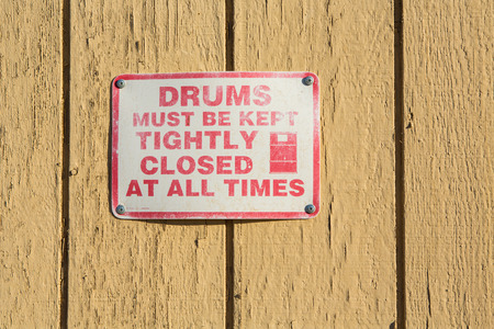 Caution .This drums must be kept closed. Font poster , safety and health in the workplace. Stock Photo