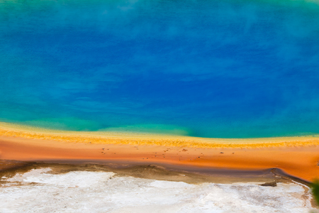 Famous trail of Grand Prismatic Springs in Yellowstone National Park from high angle view. Beautiful hot springs with vivid color blue green orange in Midway Geyser Basin, Yellowstone National Park, Wyoming, USA