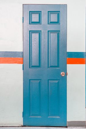 Blue Door with handle lock with blue and orange striped