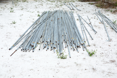 Cylindrical steel pipe or metal pipe on sand floor