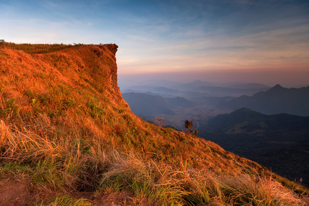 Sunset scene with the peak of mountain and cloudscape at Phu chi fa in Chiang rai,Thailand
