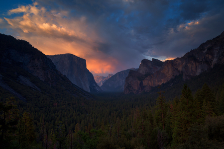 Classic Tunnel View of scenic Yosemite Valley with famous El Capitan and Half Dome rock climbing summits in beautiful golden  light at sunset in summer, Yosemite National Park, California, USA