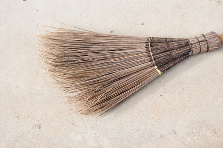 broom and coconut palms grass for recycle bin and cleansing day, on the wall witchs broomstick,