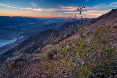 Beautiful sunset at Badwater basin seen from Dantes view, Death Valley, California, USA.