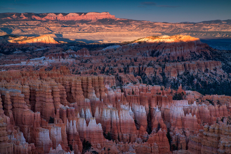 Scenic view of stunning red sandstone hoodoos at sunrise in Bryce Canyon National Park in Utah, USA