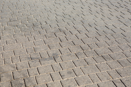 brown brick paving stones on a sidewalk background texture Stock Photo