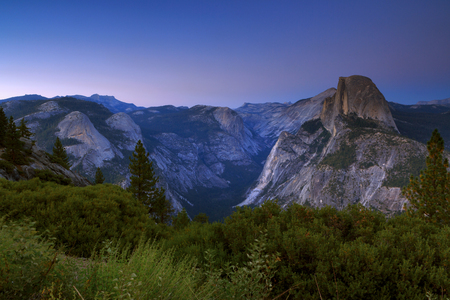 Glacier Point View of scenic Yosemite Valley with famous El Capitan and Half Dome rock climbing summits in beautiful golden  light at sunset in summer, Yosemite National Park, California, USA