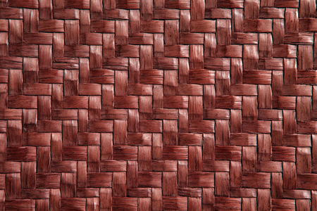 traditional thai style rattan pattern maroon color made from bamboo handcraft weave texture wicker surface for furniture material