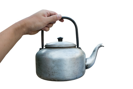 hand holding Small classic kettle for camping isolated on white background 스톡 콘텐츠