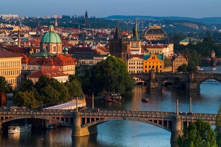 Scenic summer sunset aerial view of the Old Town pier architecture and Charles Bridge over Vltava river in Prague, Czech Republic 免版税图像 - 112335917