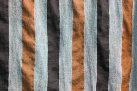 Pieces of brown fabric or canvas with strip pattern in vertical line texture and background 스톡 콘텐츠