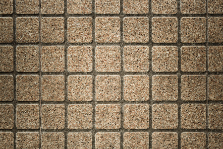 Outdoor brown square stone block tile wall background and texture high resolution