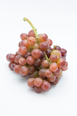 Ripe red grape. Pink bunch isolated on white background.