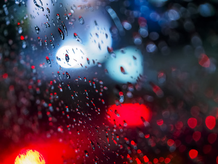 Abstract Images Rain Drops On The Mirror At Night. Take Real Focus Bokeh Stock Photo