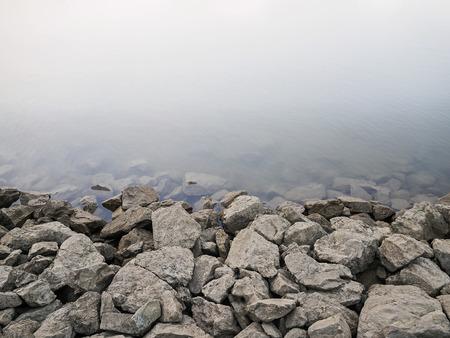 Rocky Dam on River Background Stock Photo