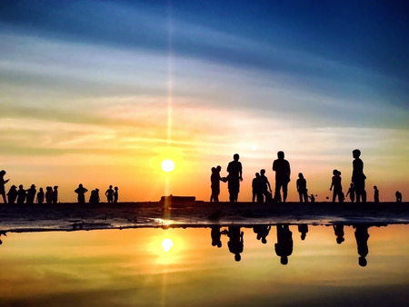 The Silhouettes are Activities on the Beach at Sunset