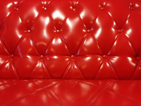 red sofa: Glossy Red Leather Sofa  Stock Photo