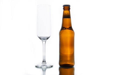 intoxicate: Bottle with beer and empty glass isolated on white background. Stock Photo