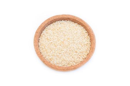 White sesame in bowl isolated on white background. Standard-Bild