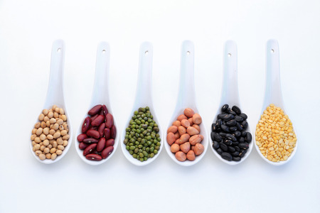 protein crops: Collection set of beans, legumes, peas, lentils on ceramic spoons isolated on white background.