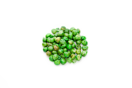 protein crops: Salt coated roast green peas isolated on white background.