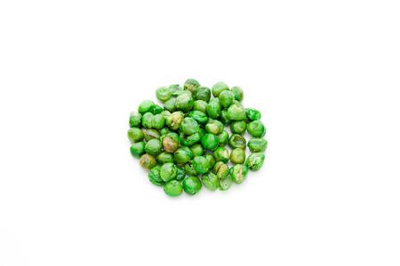 Salt coated roast green peas isolated on white background.