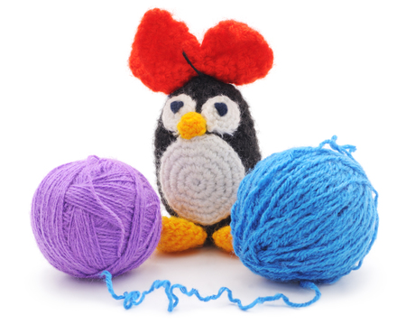 playthings: Knitted penguin isolated on a white background. Stock Photo