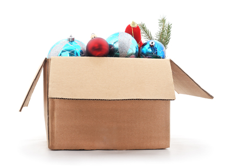 holiday ornament: A box of Christmas decorations isolated on a white background. Stock Photo