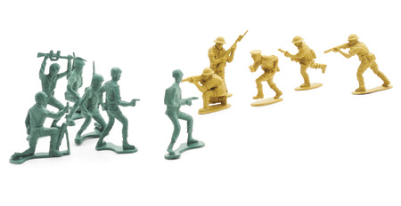 green plastic soldiers: Toy soldiers isolated on a white background. Stock Photo