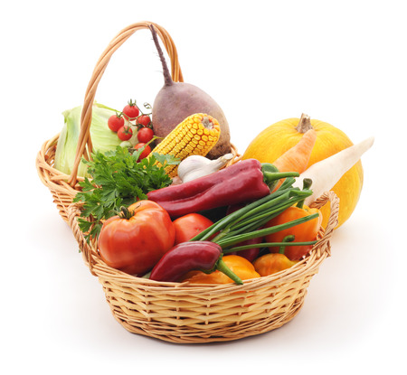 Vegetables in baskets isolated on white background.