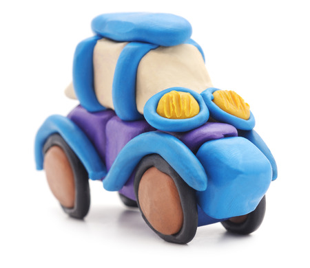 traffic: Plasticine car isolated on a white background.