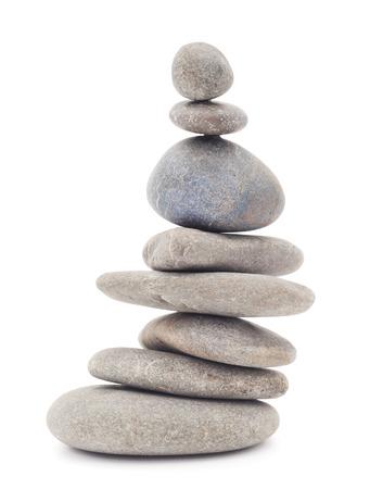 white stones: Pyramid of stones isolated on white background. Stock Photo